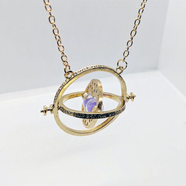 Timeturner ketting goud met paars zand